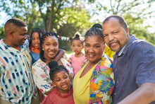 Portrait Happy Multigenerational Family In Summer Park