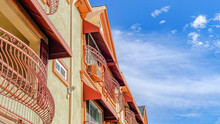 Pano Residential Building With Curved Wrought Iron Railing On Windows And Balconies