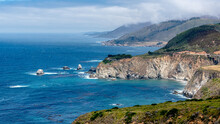 High View Of Mountain And Cliff With Pacific Ocean In Big Sur, California. Highway One