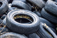 A Bunch Of Old Tires From Used Cars.