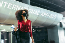 Businesswoman With Face Mask On Arrived At International Airport