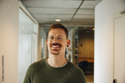 Fotografie, Obraz Portrait of happy male executive in office