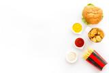 Fototapeta Kawa jest smaczna - Junk food with hamburger chicken nuggets and french fries
