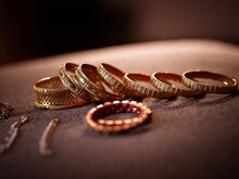 Closeup Of Traditional Indian Gold Rings And Other Jewelry