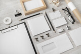 Fototapeta Kawa jest smaczna - Blank stationery template on light wooden background. Mock-up for branding identity. For design presentations and portfolios.