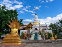 Golden Meditated Buddha Statue With Naga Covered Behind And White Pagoda At Wat Phra That Doi Leng Temple On The Mountain With Blue Sky, Travel Attraction In Phrae, Thailand