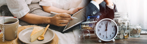 Fotografiet Male hand putting coins with money stack step growing growth and dollar bag