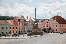 Benesov Nad Ploucnici, North Bohemia, Czech Republic, 26 June 2021: Marian Column With Baroque Statues At Main Town Square, Old Baroque Historic Buildings And Town Hall At Summer Sunny Day