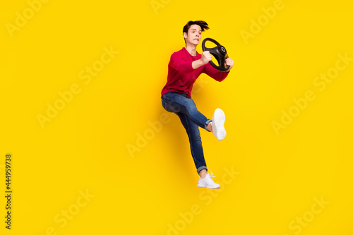 Obraz na plátne Full length photo of shocked impressed young gentleman wear red sweater jumping