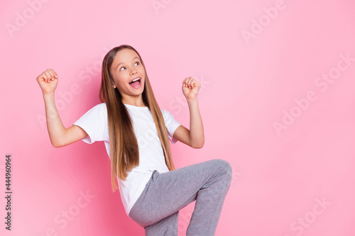 Fotografia, Obraz Photo of nice impressed blond girl look empty space wear white t-shirt isolated