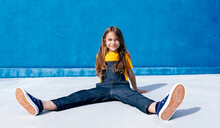 Happy Teenager In Cool Outfit On Blue Background