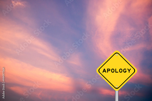 Canvas Print Yellow transportation sign with word apology on violet sky background
