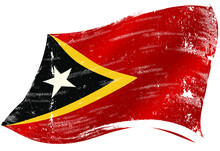 East Timor Waving Flag. Flag Of East Timor With A Texture In The Wind.