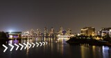 White chevron pattern design against view of cityscape at night