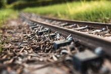 Detail Of The Old Sleepers That Hold The Rails Of A Small Train Track.