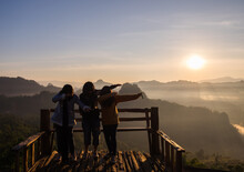 Mae Hong Son - Dec 16 2016 : Tourists Women Group Standing Poses On Wooden Terrace Famous