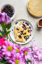 Wild Blueberry Crepes With Purple Flowers.
