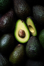Avocados Whole And Sliced Background Pattern