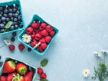 Strawberry, Raspberry, Blueberry Fruits On A Blue Background
