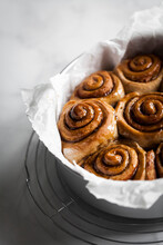 Cinnamon Buns In A Round Pan With Parchment Paper.