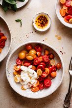 Caprese Salad With Burrata Cheese In A White Bowl