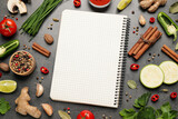 Blank recipe book and different ingredients on grey table, flat lay. Space for text