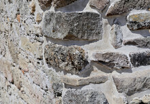 A Section Of The Wall Of An Ancient Roman Fortification Made Of Large Blocks And Stones