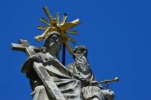 Detail Of Sculptural Group Of The Holy Trinity On Column In Gabcikovo, Southwestern Slovakia, In Summer Dayligh Sunshine, Clear Skies In Background. Build Around 1890, Restored In 2008.