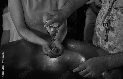 Billede på lærred baptismal font with oil and closeup hands
