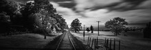 The Infrared Landscape Of Railway On The Riverbank Of Cape Cod Canal In Massachusetts. Retro-style Blue Monochrome Image With Space For Text And Design.