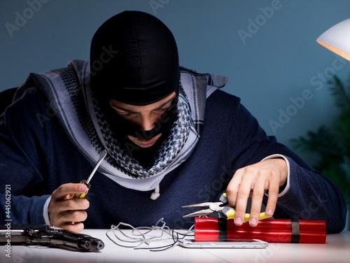 Fotografering Terrorist bomber preparing dynamite bomb
