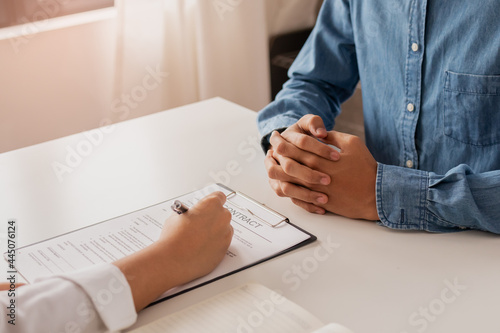Close up hand of tenant, client sign signature contract rental, purchase, buyer home or apartment with landlord, realtor after banker agreement mortgage, loan success or done Fotobehang
