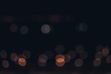 Horizontal Dark Background With Orange Bokeh Lights