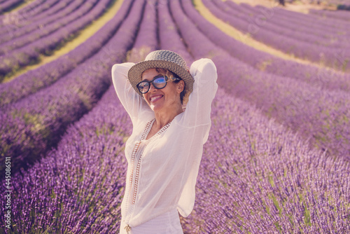 Fotografie, Obraz Summer style portrait of cute middle age woman smiling and having fun with viole