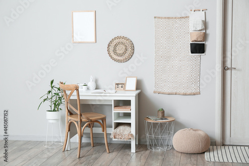Tableau sur Toile Interior of light room with comfortable workplace