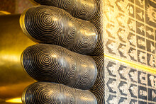 Close Up On Details Of The Reclining Buddha Statue At Wat Pho In Bangkok, Thailand.