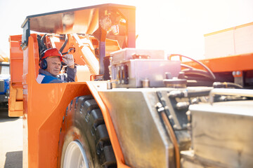 Driver man of construction equipment excavator or tractor. Builder or mining industrial work