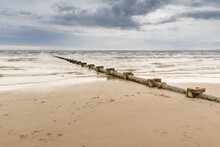 Sewage Or Waste Water Discharge Pipe Leading Out To Sea On A Beach