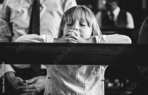 Obraz na plátně A child praying inside the church