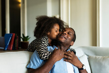 African Kissing His Father