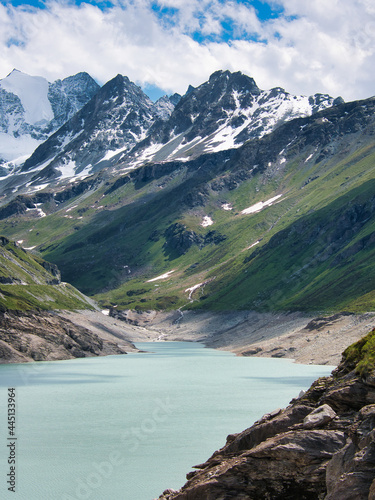 Fototapeta Water of the reservoir Lac de Moiry in the Swiss Alpine valley val d'Anniviers