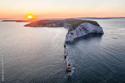 Fototapeta The Needles Isle of Wight with The Needles Lighthouse taken from the air at dawn with a still sea and crisp light