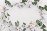 Top view image of flowers composition on white background .Flat lay