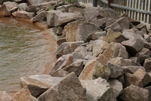 Piles Of Natural Stones By The Lake