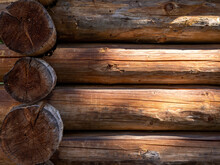An Old Cottage Wall, Made Of Wooden Logs. A Background With Copyspace.