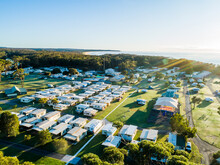 Coastal Holiday Caravan Park In Morning Light With Rows Of Cabins