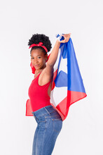 Latina Woman Dancing While Holding The Flag Of Puerto Rico: Patriotic Concept
