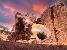 Fragment Of Ancient Structure In Cyprus. Attractions Of Paphos. Wall Of Ancient Building. Archaeological Museum At Sunset Time. Cyprus Archaeological Park Landscape. Complex Tomb Of Kings In Paphos