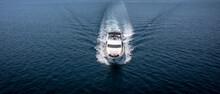 Aerial View Of Luxury Speedboat Yacht Cruising In Deep Ocean Water.