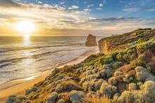 Sunset Over The High Cliffs And Vegetation Along A Rugged Coastline